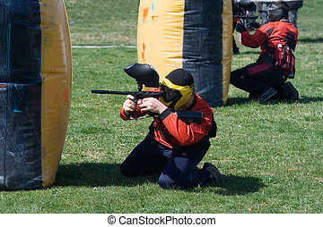 Paintball match - Two paintball players defending their...