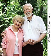 Senior Couple Holding Hands - A portrait of a loving senior...