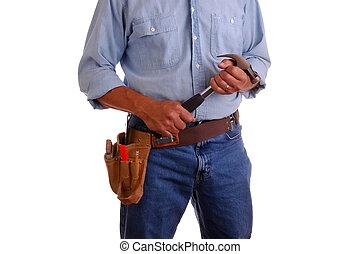 Carpenter holding hammer