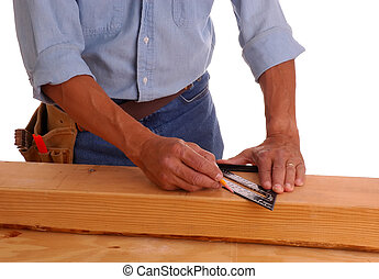 Carpenter marking cut line on lumber isolated over white