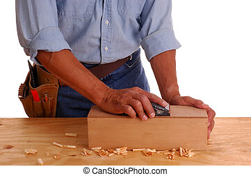 Carpenter holding ruler and pencil