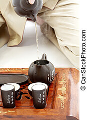 tea ceremony - closeup picture of tea ceremony set in action