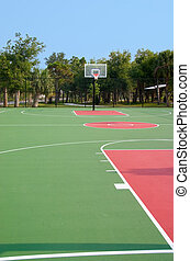 Basketball Court - Basketball backboard and hoop at end of...