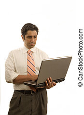 Young executive usinfg a laptop computer