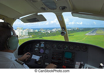 Pilot is getting ready for landing overlooking the city,...