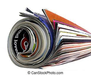 magazine - rolled up magazine on white