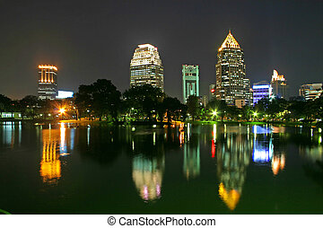 Bangkok Park - View across Lumpini Lake and downtown...