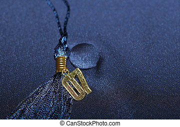 Graduation 07 - Gold 07 tassel on background of blue...