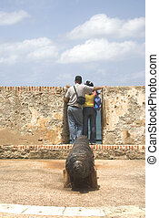 tourists at el morro - tourists looking out to sea at el...