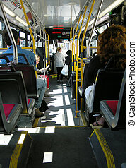 transit city bus - passengers getting off and on a city...