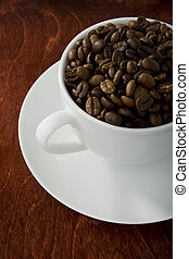 coffee cup - Coffee cup filled with brown coffee beans
