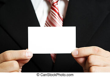 Businessman - A businessman holding up a blank business card