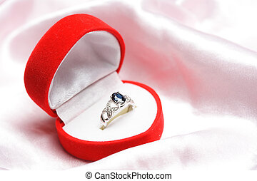 Diamond ring - A diamond sapphire ring in a jewelry box