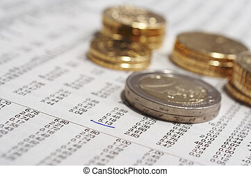 Coins and stock quotation - Stcok quotations and stack of...