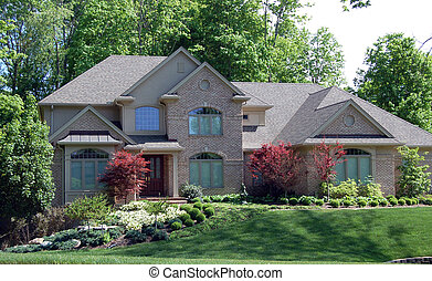 Beautiful home on wooded lot with lovely landscaping