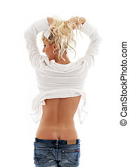 lovely blond in blue jeans pulling hair up - picture of...