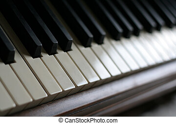 Piano Keys - A closeup of the keys of a piano, shot with...
