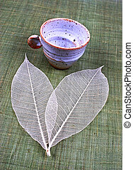 Pottery cup and leaves - Pottery cup and pretty spring...