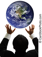 Global business - A businessman trying to catch the globe...