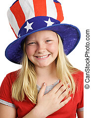 Saying The Pledge - A pretty American girl smiling and...