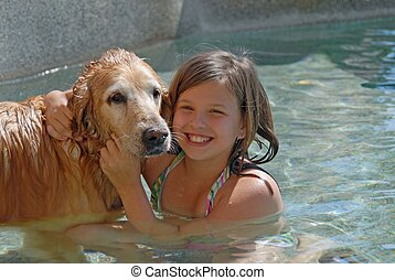 swimming with my dog - girl and golden retriever in swimming...