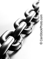 chain macro on cold brushed metal, heavy duty chain with...