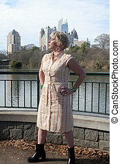 Woman by lake in park