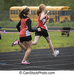 Two Sprinters Crossing the Finish Line - Two sprinters in...