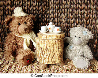 tea-party - two teddy-bears sitting at the table having the...