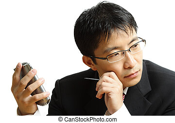 Planning businessman - An isolated shot of a businessman...