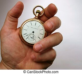 Pocket Watch Hand - Hand holding 19th century antique gold...