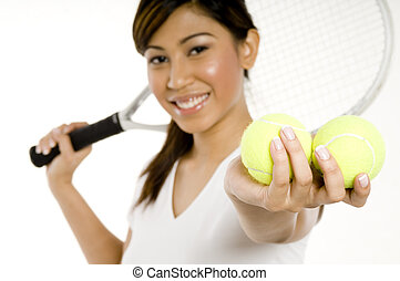 Woman Holding Tennis Balls - A young attractive asian woman...