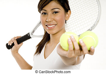 Female Tennis Player - A young Asian woman holding a tennis...