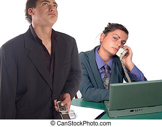 Business team - Young business man and woman using his...
