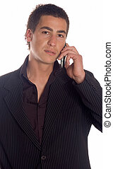 Businessman making a call - Young adult business man using...