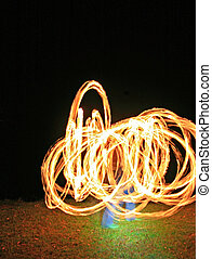 Fire dancer 1 - A fire dancer with fire trails creating...