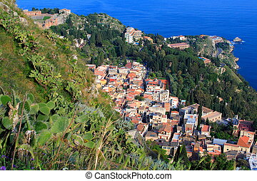 Mediterranean village in sicily italy called Taormina with...