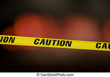 caution tape - Caution tape over a black background with...