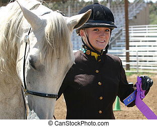 The Winner - Beautiful young woman in English riding attire,...