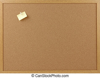 Message Board - Cork message board with a blank note held...
