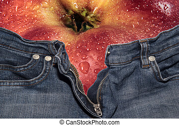 Phisical exercise - Red apple into a cowherd trousers