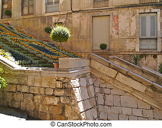 Old Girona steps with flowers 01