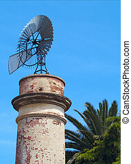 Windmill water pump 02 - Windmill water pump on top of a...