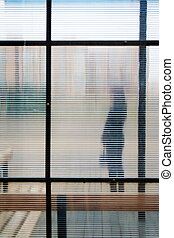 On a bus stop. - Silhouette of girl through glass. On a bus...