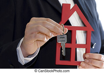 key and house - hand hold a key and a house for sale ( sales...