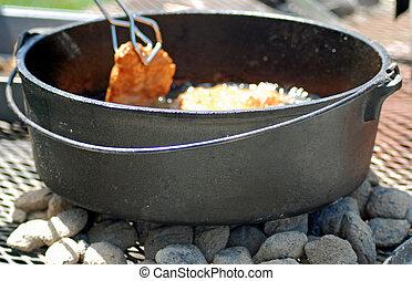 Frying in Dutch Oven - Frying scones in an iron dutch oven...