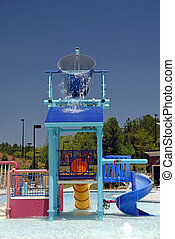 Small Waterpark - A swimming pool area with a waterpark for...