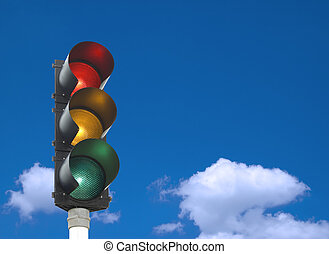 Traffic lights - all three lights are on in front of blue...
