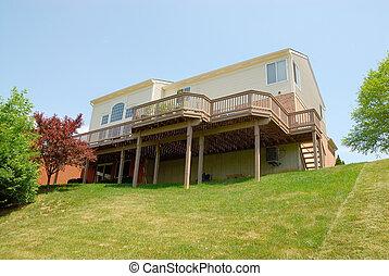 Residential Sloped Back Yard - Residential 2-story house...
