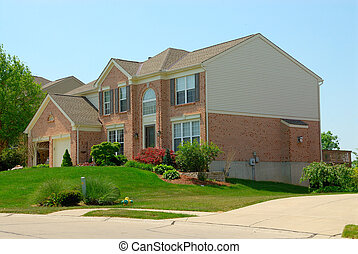 2-story Brick Suburban Home - A 2-story brick home in the...